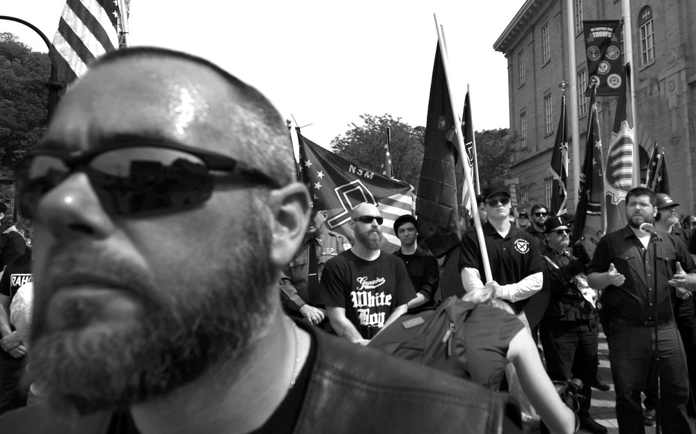 White nationalist Matthew Heimbach, far right, address a white supremacist rally and anit-fascist protesters Saturday, April 29, 2017, in Pikeville, Ky.