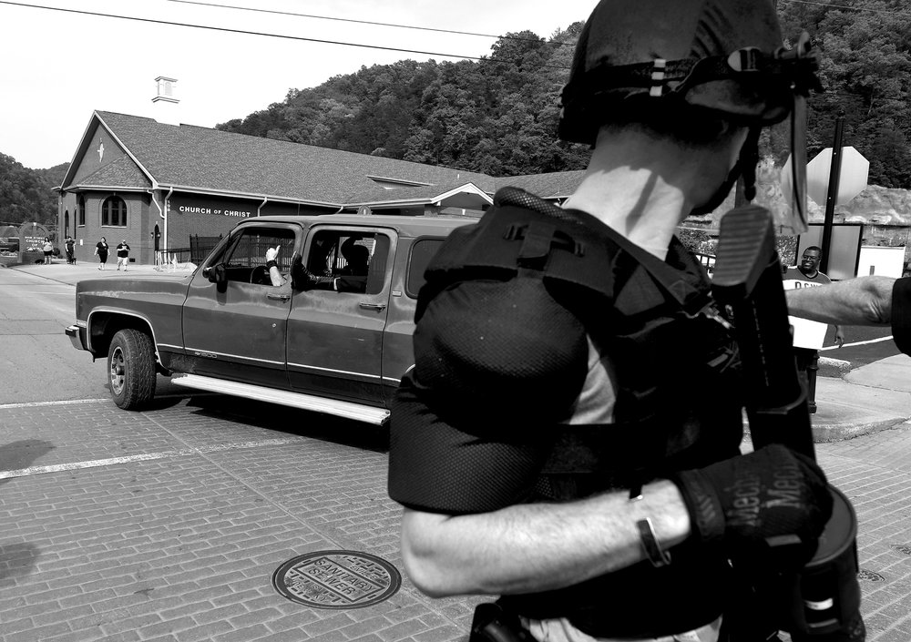 A Kentucky State Police tactical officer watches as white supremacist groups leave Pikeville, Kentucky Saturday, April 29, 2017 after a day of protests and counter protests shut down the city.