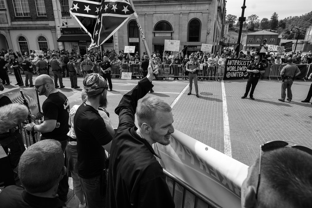 White supremcist groups face off against anti-fascist protesters across a Pikeville, Kentucky street Saturday, April 29, 2017.