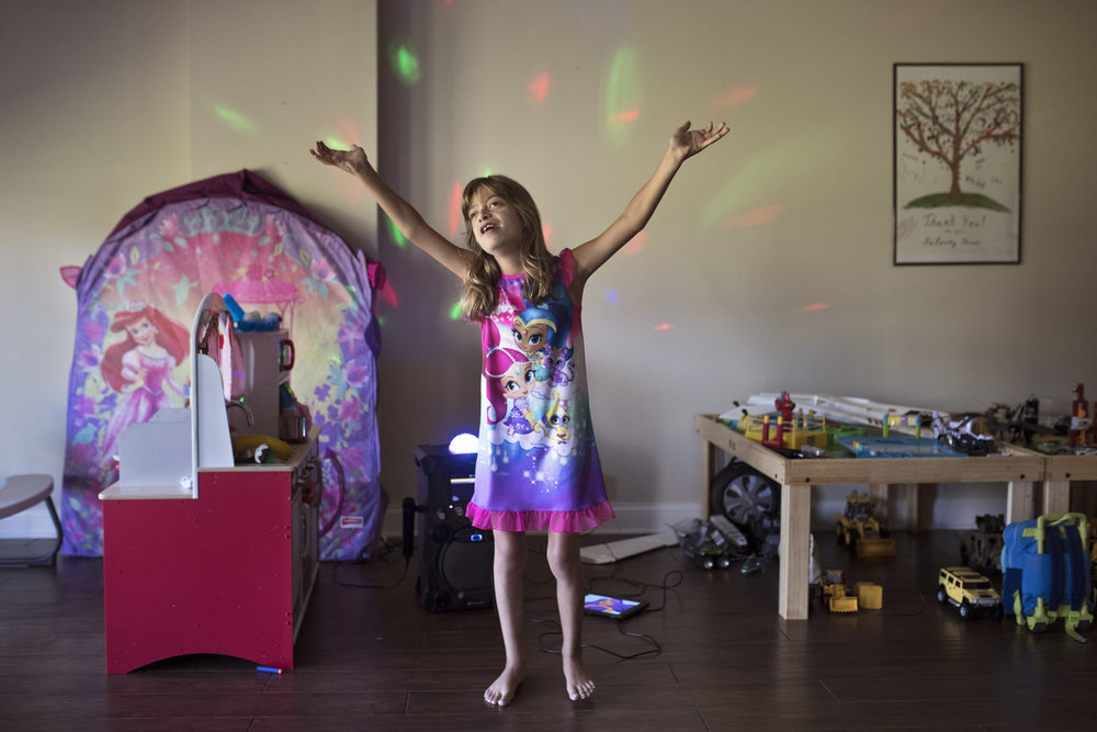 "Danica Zahradnicek, 6, practices singing ""Legend of the Blue Mermaid"" from the Team Umizoomi show in the basement of her home. Zahradnicek, was born with Mosaic Turner syndrome and hypoplastic left heart syndrome. She had open heart surgery at day two, six months, and three years. Each year, Zahradnicek looks forward to competing in the Oldham County Fair Special Needs Pageant, where she gets to perform for the audience and dress to impress. Aug. 5, 2017"
