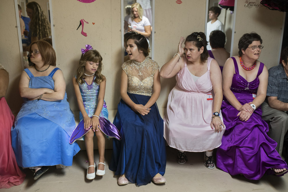"Danica, second from left, sits with other 2017 Oldham County Fair Special Needs Pageant contestants before the start of the event. ""This is the sixth year that I've had the Special Needs Pageant,"" pageant director Sondra Cawthon said. ""It's a pageant that's not just for their looks, it's their personalities, the love in their heart and the openness in their spirit."" Aug. 5, 2017"