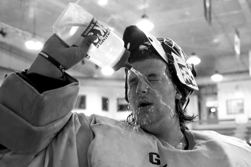 Goalie Eric Williams cools off during practice at the Lexington Ice Center. The team practices twice a week at 10 p.m. after business closes at the rink.