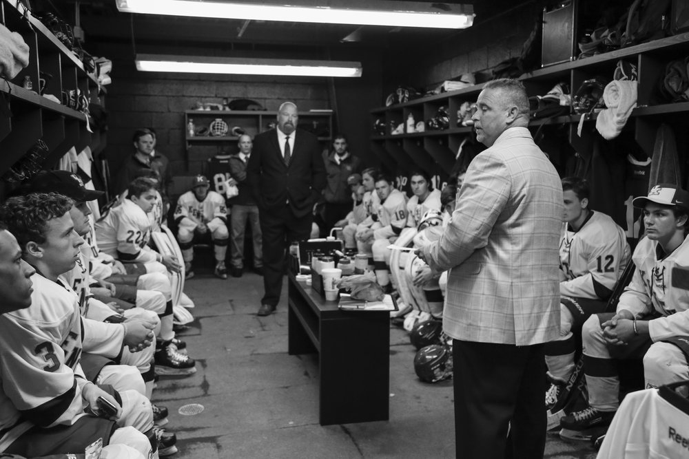 Coach Tim Pergram addresses the team in their locker room prior to their first game against Middle Tennessee State.