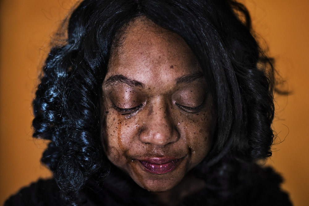 "Tiffanie Thomas Harris, 42, has tears stream down her cheeks as she recalls the giving nature of her son, Nicolas Thomas, who was shot and killed in Louisville's west end on Feb. 17, 2017. ""He held a backpack drive for kids in need in 2015 where he collected and gave away 50 backpacks,"" Harris said. ""He was a leader among his friends."" Since 2015, Harris has lost her son and her brother to shootings in the west end. ""My brother's murder? Unsolved. My son's murder is unsolved. I don't even hear from homicide,"" Harris said. ""What makes his life so unimportant that he can be murdered and I don't hear anything?"" Due to the high rate of violence in Louisville's west end, Harris, the mother of seven living children, often holds a daily roll call where she calls each of her children to make sure they're okay. ""It seems like every other day there's a shooting in the west end,"" Harris said. Dec. 8, 2017"