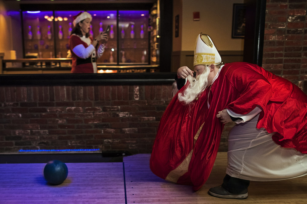 Nick Platt bowls at Fourth Street Live's Sports and Social bar during the Santacon event in downtown Louisville on Saturday afternoon. Over 100 participants dressed in different iterations of Santa Claus and spent the evening bowling and bar hopping around downtown Louisville. Dec. 9, 2017