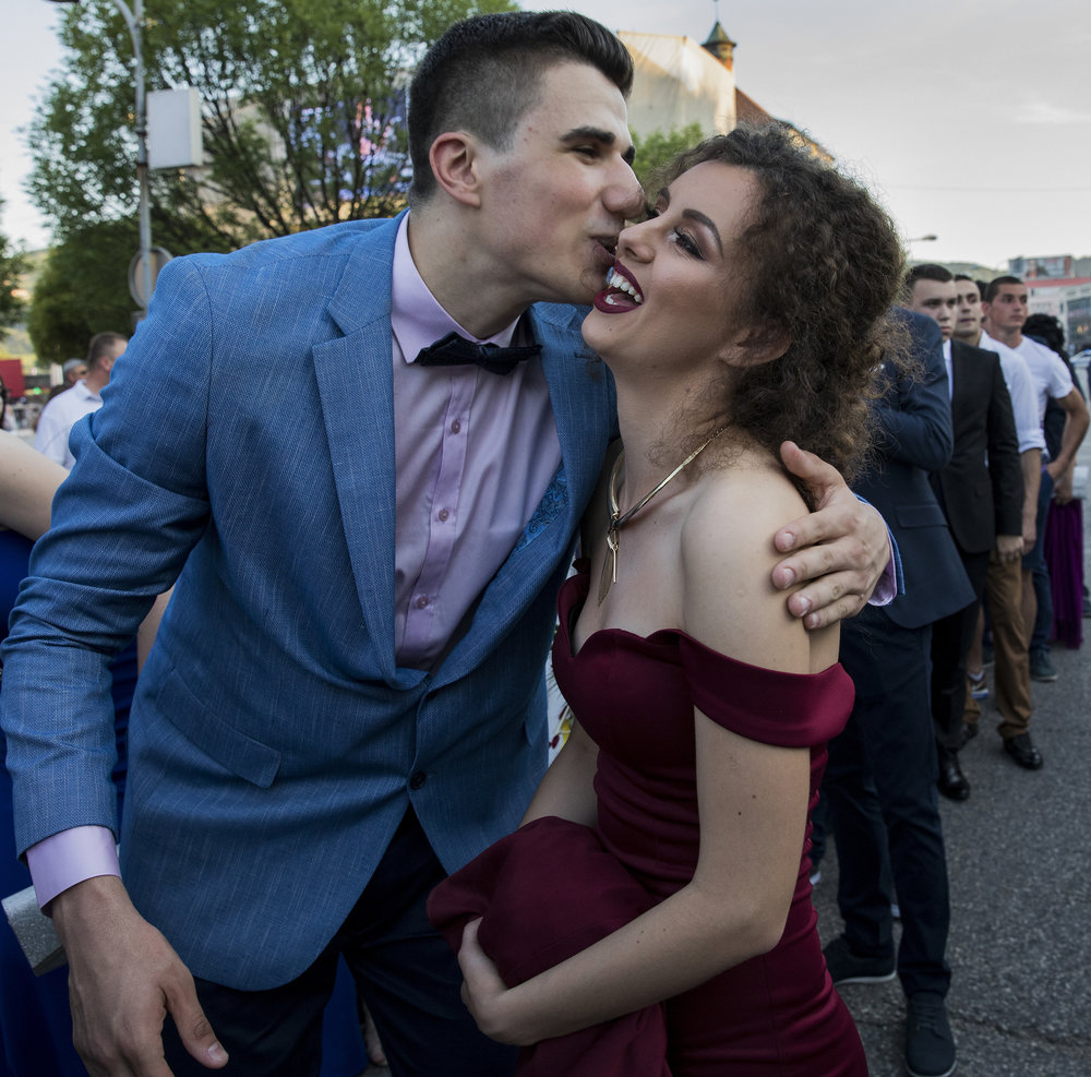 Hundreds of people gathered in the streets of Banja Luka, Bosnia, during a celebration that preceded the city's prom night event. High school students greeted each other, then lined up to march in the streets and take pictures by a Serbian Orthodox church before entering the hotel that was hosting the event.