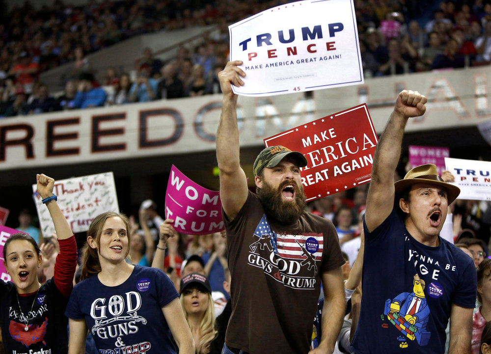 Supporters of President Donald Trump react during his speech at Freedom Hall, in Louisville. March 20, 2017
