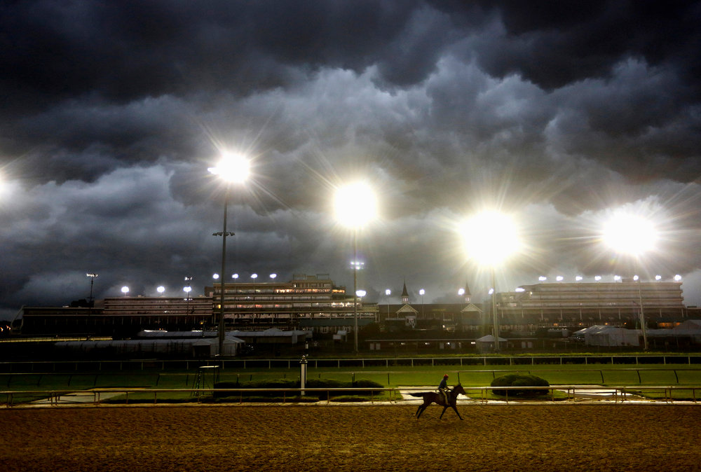 A lone horse galloped on the track during morning workouts prior to the Kentucky Derby, as a storm front moved across Churchill Downs during morning workouts. April 29, 2017.
