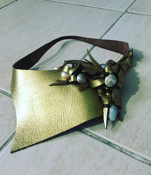 Spring is near!!! 🤩 Neckwear made by Digdem always makes a statement simply and beautifully.  Taking orders now, DM us!! Metallic gold leather that is wearable and lightweight.  Highlighted with turquoise and pearls, perfect for warmer days up and coming with your cami or favorite 👗 ❤️#neckwear #necklace #leatherhandmade #leather #handmade #handcrafted #leatherandpearl #pearl #turquoise #fashion #editorial #fashionblogger #fblogger #blog #style #styleblogger #jewelry #couture #designer