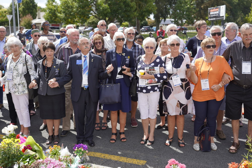 Rotary members join hands with mosque members from the Boundary Road Mosque, Hamilton.