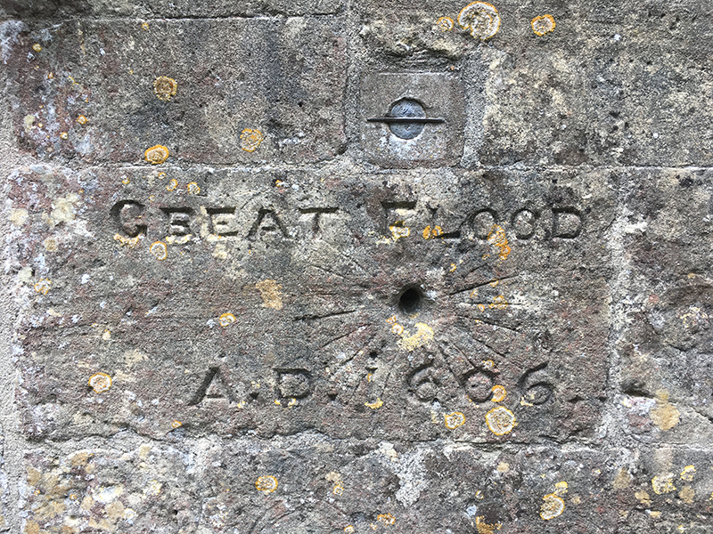 Engraved commemoration on church porch showing extent of flood, St Thomas', Redwick.