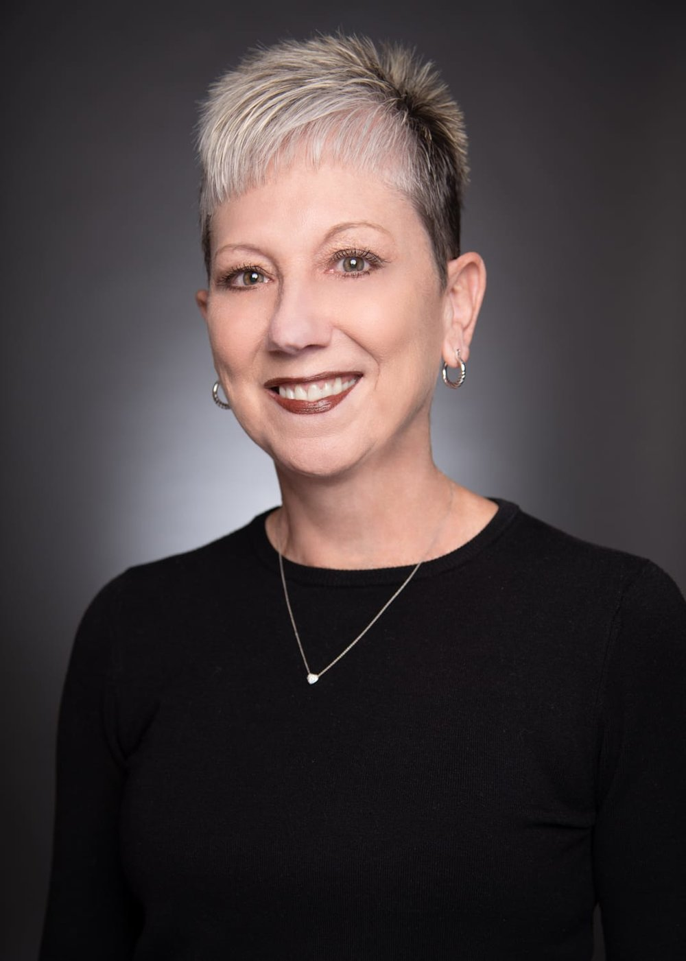 Debbie Carroza  Lease Administrator