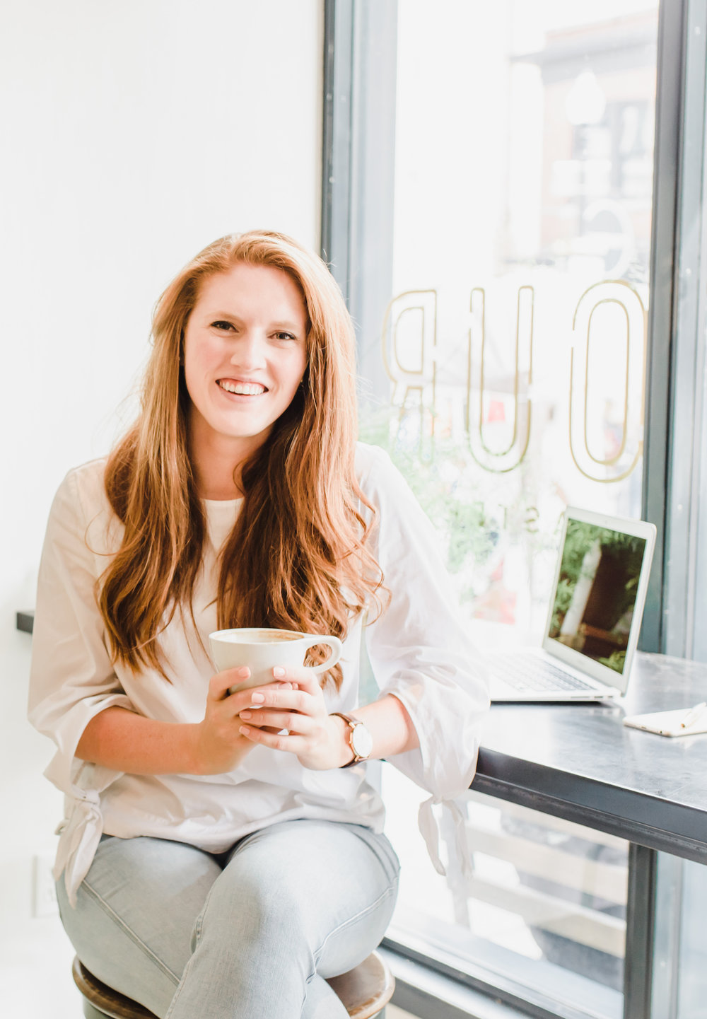 Paige Brunton in a cafe working on her squarespace business.jpg