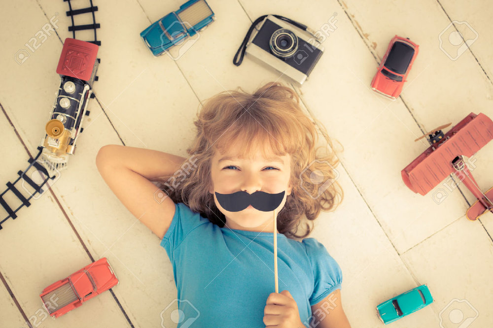 33371372-Hipster-kid-with-vintage-wooden-toys-at-home-Girl-power-and-feminism-concept-Stock-Photo.jpg