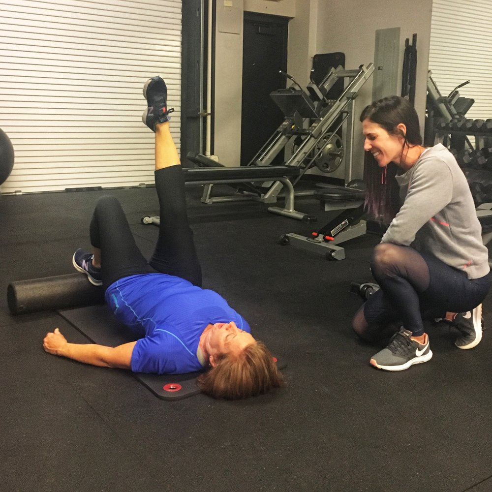 Katie's personal trainer added a foam roller to her single leg bridges to add some instability to her workout.
