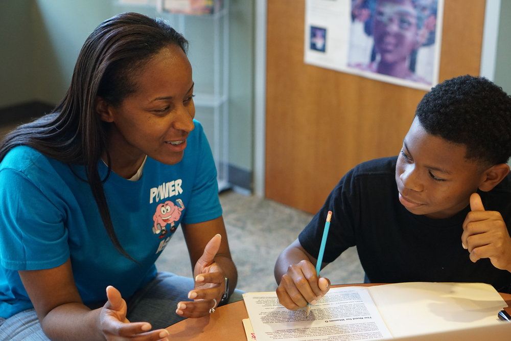 Founder and Lead Tutor, Cherelle, works with a POWER learner.