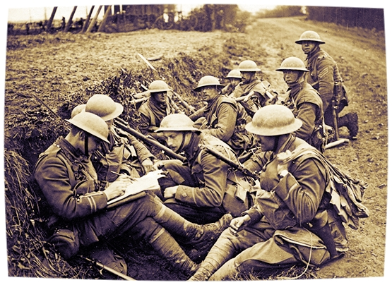 British troops huddle in a trench on the Western Front.
