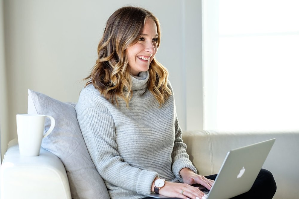 Vancouver Realtor Elsbet Doucette on Laptop Smiling