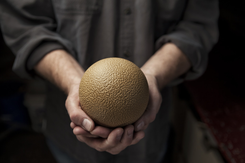 """Bruce Gardner, the second subject in the Buck the Cubicle series, makes Hikaru Dorodango. Hikaru Dorodango is a Japanese art form that translates as """"Shiny Dumplings"""". It involves making a ball of dirt and covering it with finer and finer particles until it shines."""