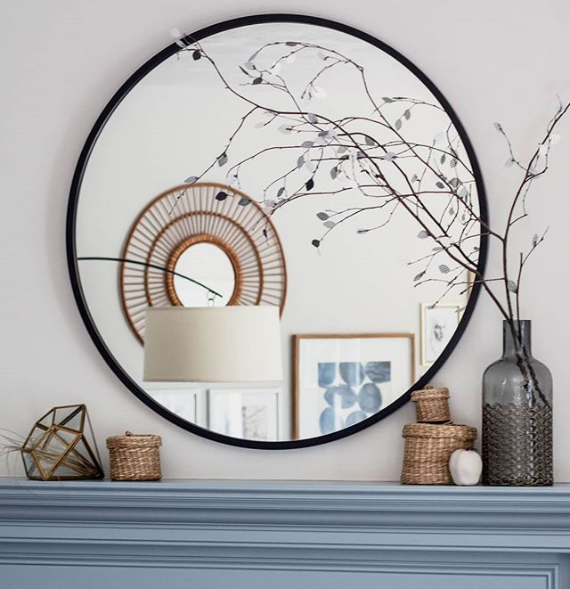 "This mirror transformed my living room and it's on super sale at @allmodern. It's usually around $150 but today it's $101 with free shipping! Search ""Umbra Hub mirror"" and treat yo self. You're welcome :) P.S. Those branches are amazing for filling space in an airy, graphic way. Check out @makandcoandover to pick some up. * * *  #designlife #homedecor #designdetails #bloomintheblack  #homestylinginspo #mirror #mantle #mantledecor #homestylinginspo #sale #shopsmall #shopandover #gallerywall #blue #slate #slateblue #fireplace"