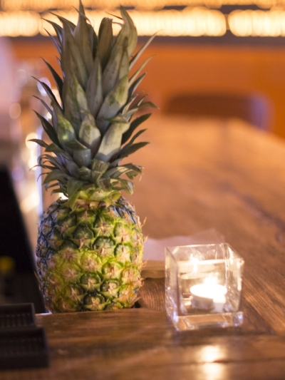 Tiger Mama's extensive list of tiki cocktails requires that pineapples be available at all times.  Photograph by Lydia Carmichael