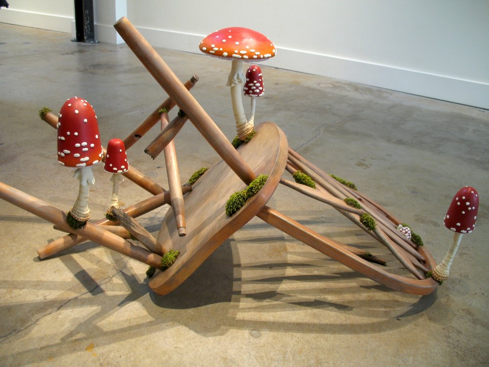 "Toadstool  ,  wood, found chair, epoxy clay, acrylic paint, flocking, dried moss, 31""x26""x24"","