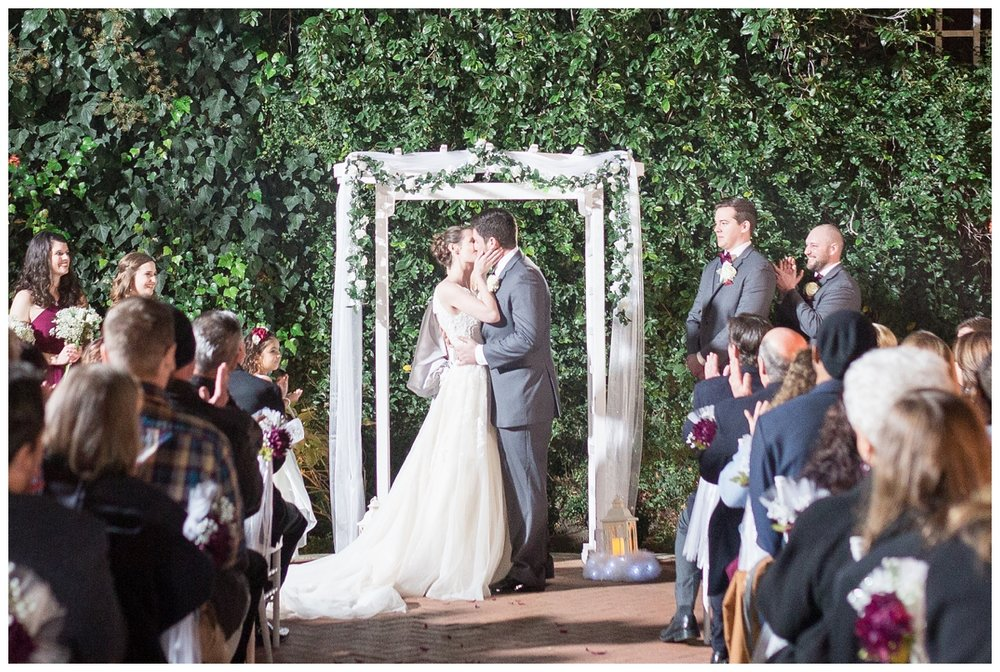 romantic ceremony at the courtyard at Vizcaya Sacramento