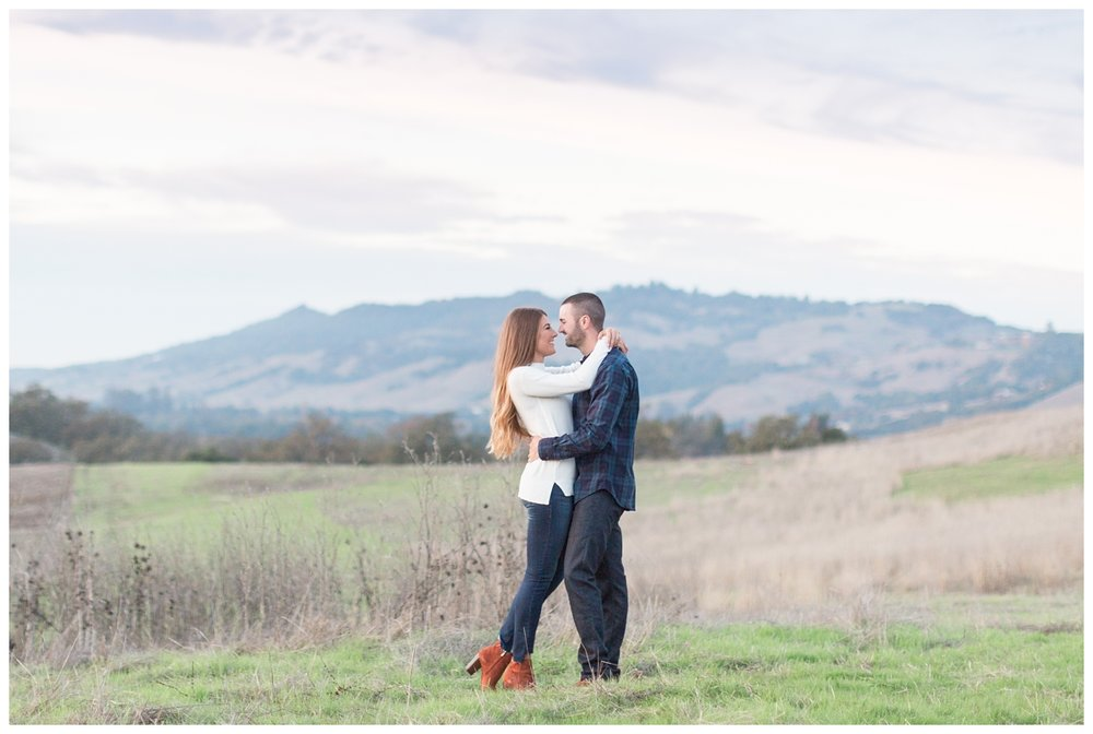 bride and groom take sunset photos on a mountain range with their wedding photographer who is from Northern California