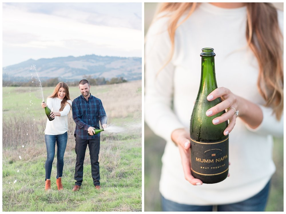 romantic sunset photos taken by a Sonoma engagement photographer up on a hill with champagne