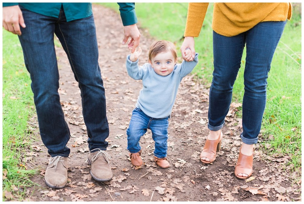 cute one year old baby walking by himself in Bidwell Park during family portrait time