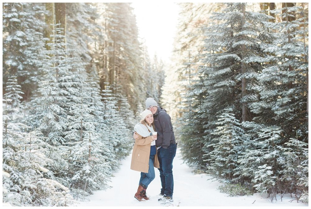 cute couple has their portraits taken in the snow near Chester California in the woods