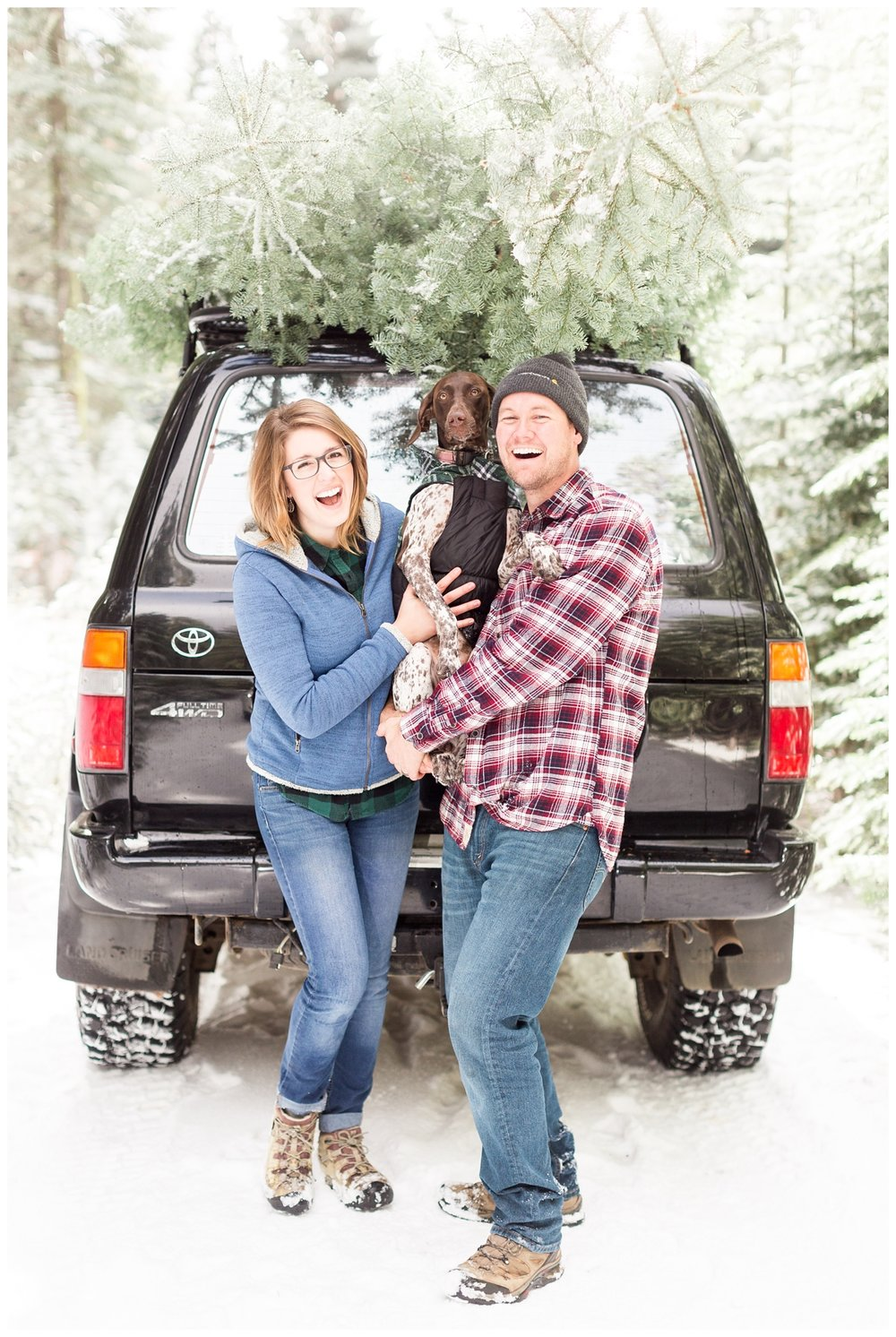 adorable couple takes a photo in the snow with their dog in the Northern California Sierra Nevada mountain range