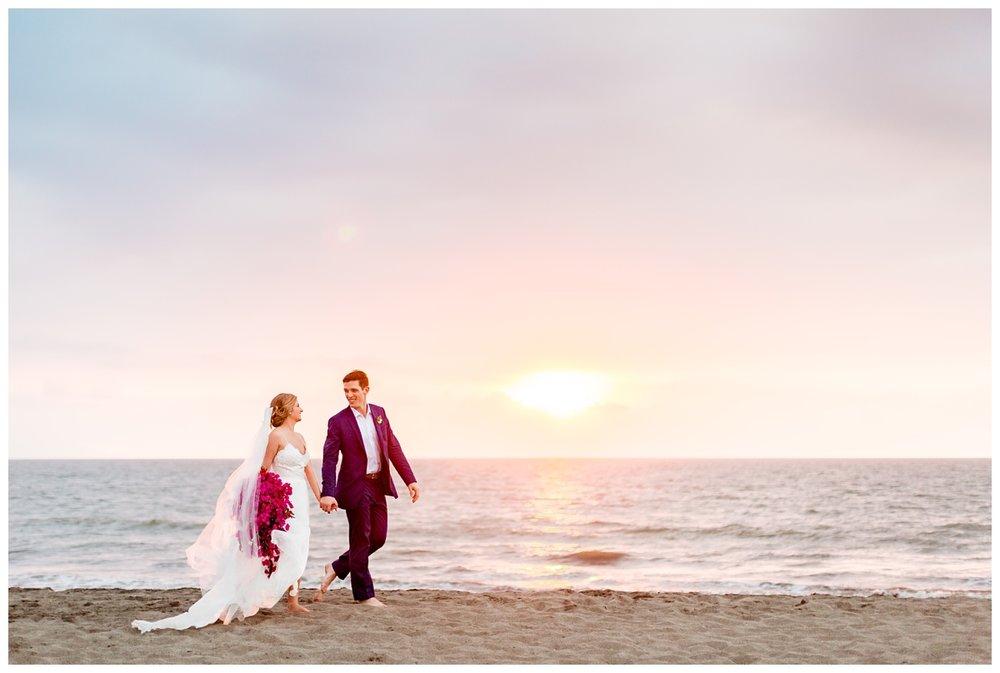Puerto Vallarta destination Mexico wedding photographer takes photos of couple on the beach at sunset time