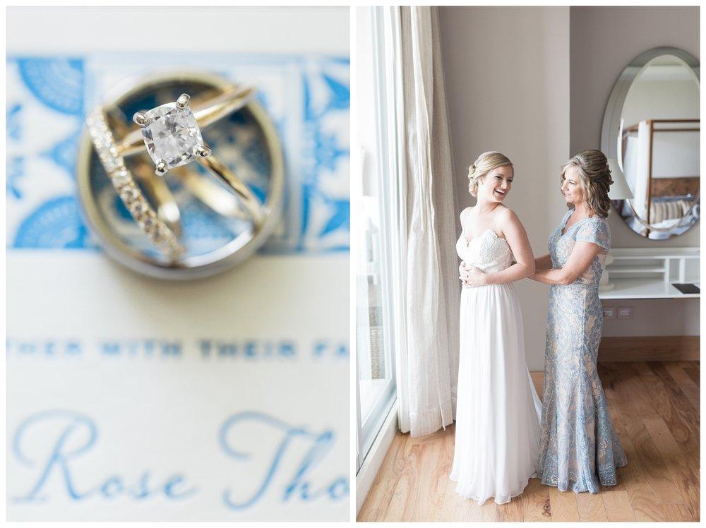 bride having help from her sister while she puts her designer wedding bracelet on