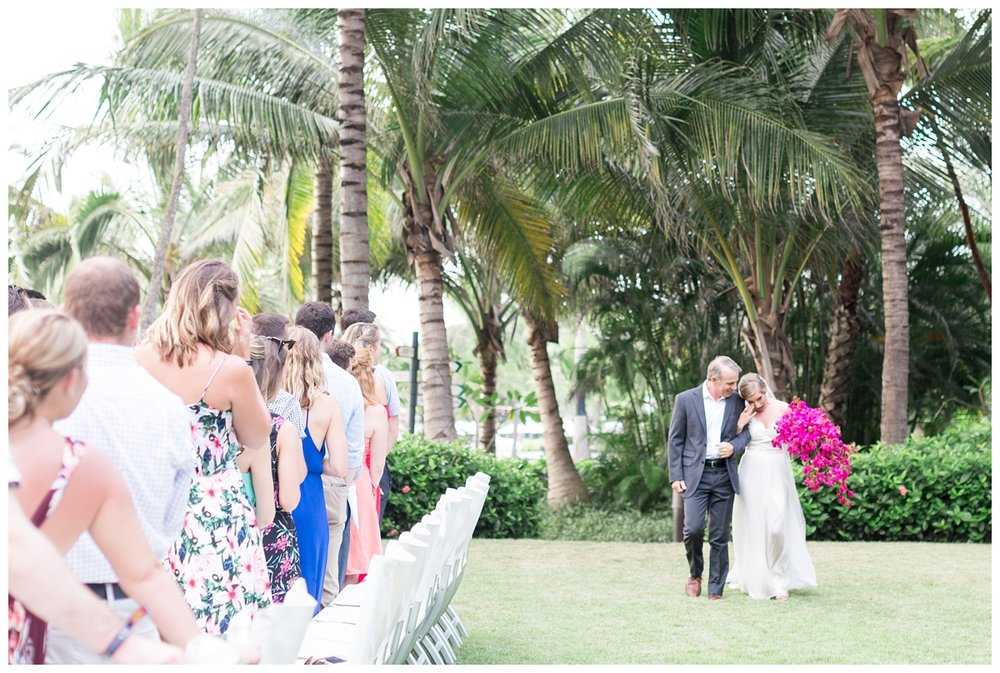 bride and groom having their destination wedding ceremony right next to the beach in Mexico