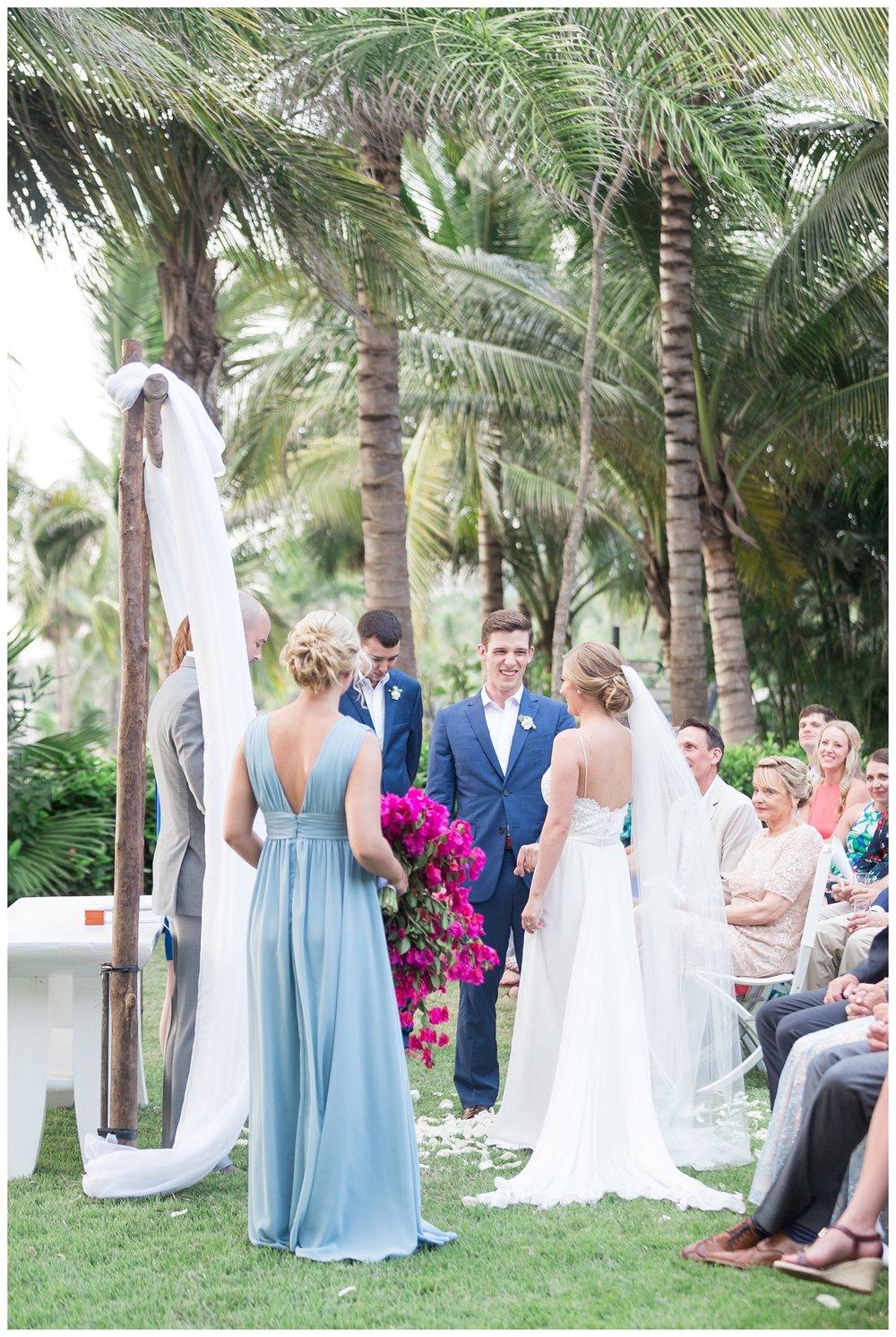 full photo of a wedding ceremony happening next to the beach in Puerto Vallarta Mexico