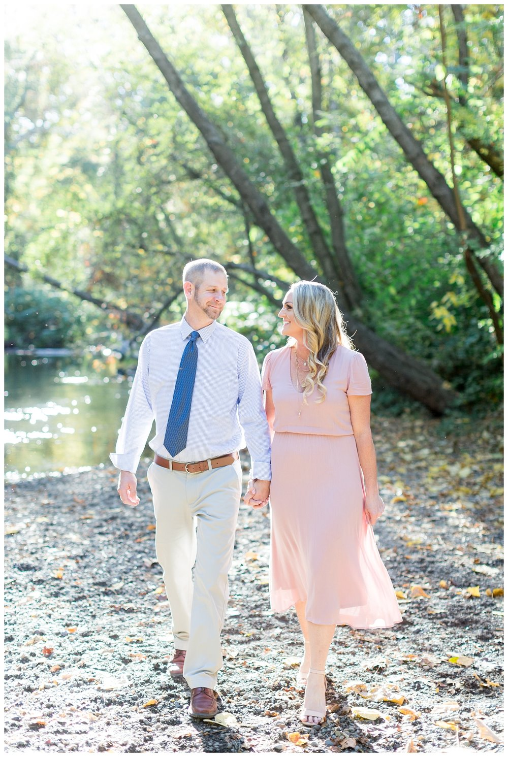 super cute couple walking hand in hand together for their engagement photo session in Chico California in Lower Bidwell Park