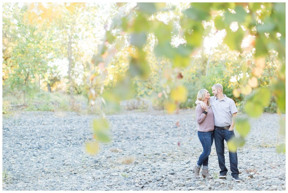 bride and groom take photos in Lower Bidwell Park with lots of Fall colors showing in the background