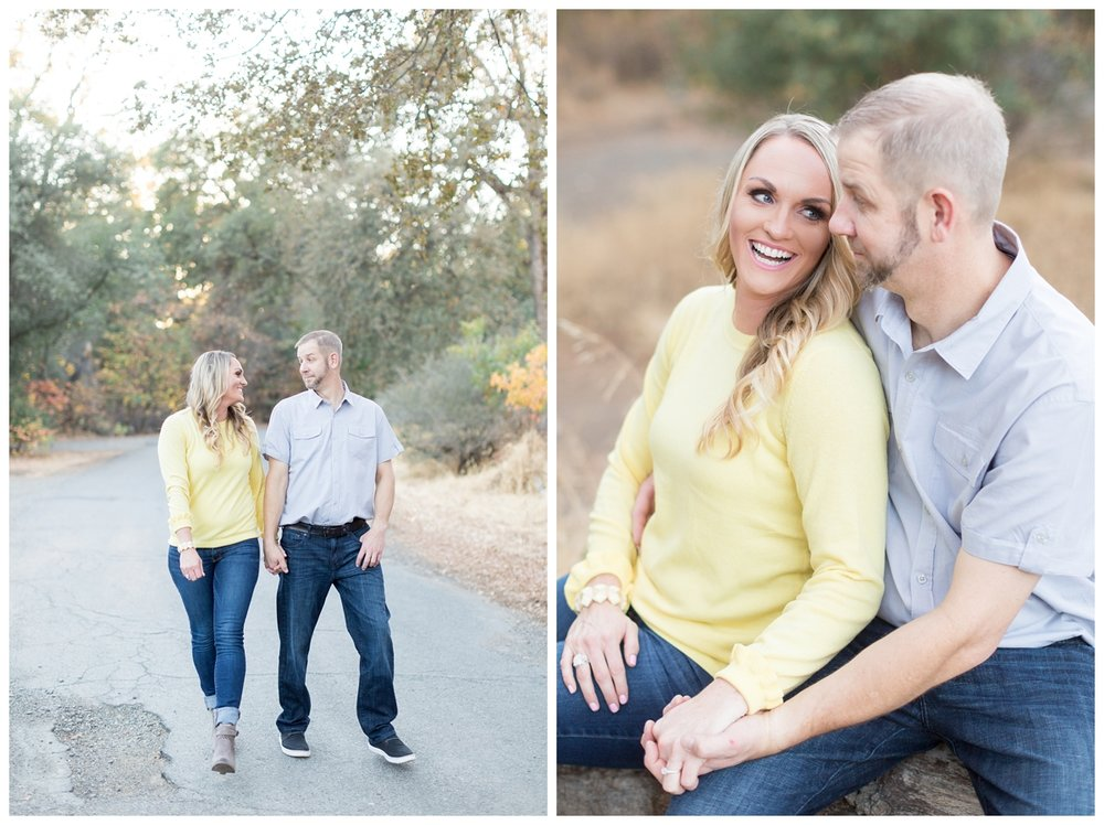 bride and groom are sitting together walking and laughing together while they have their engagement photos taken