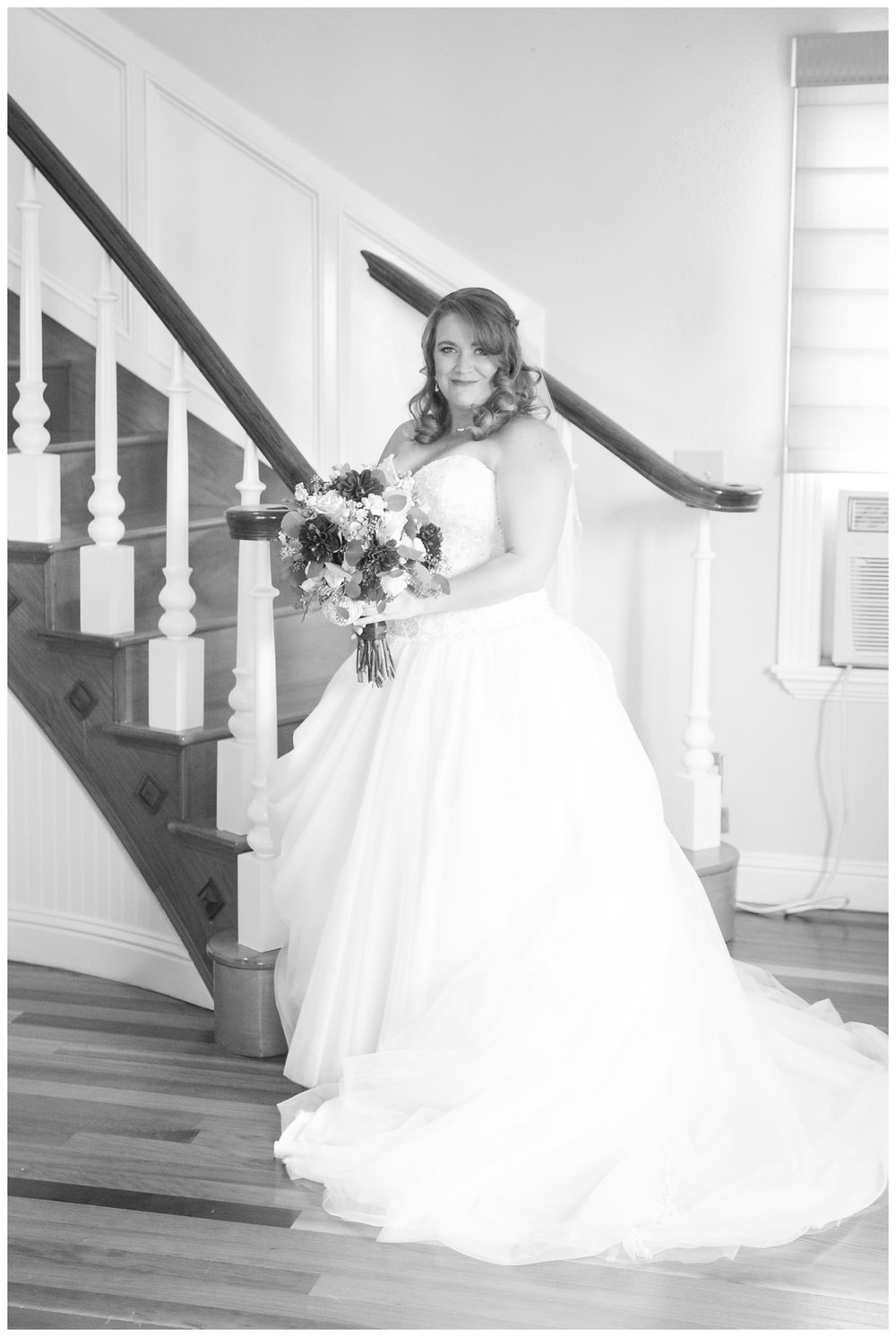 bride on the stairs in her parents home on her wedding day in Northern California