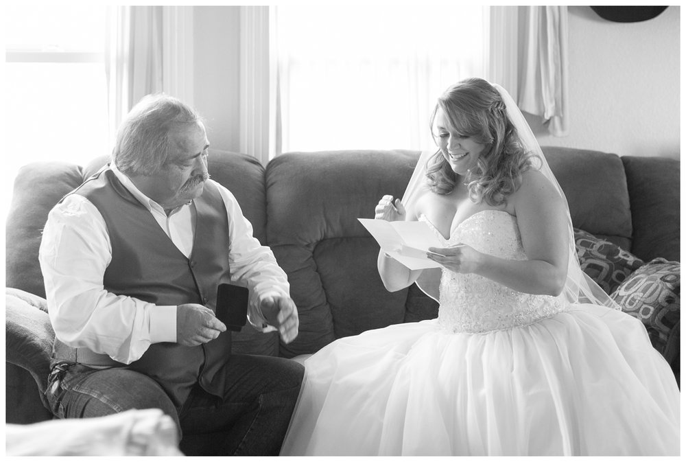 bride gifting and reading her dad a letter on her wedding day in Northern California