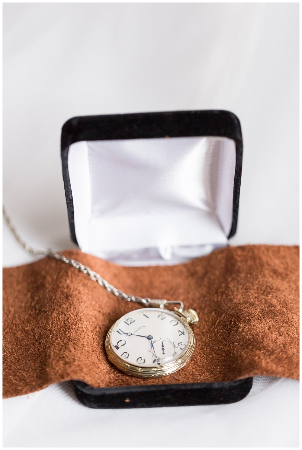 daughter gifts her dad a pocket watch on her wedding day in Northern California