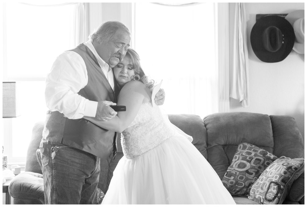 bride gives her dad a hug on her wedding day after gifting him something very special