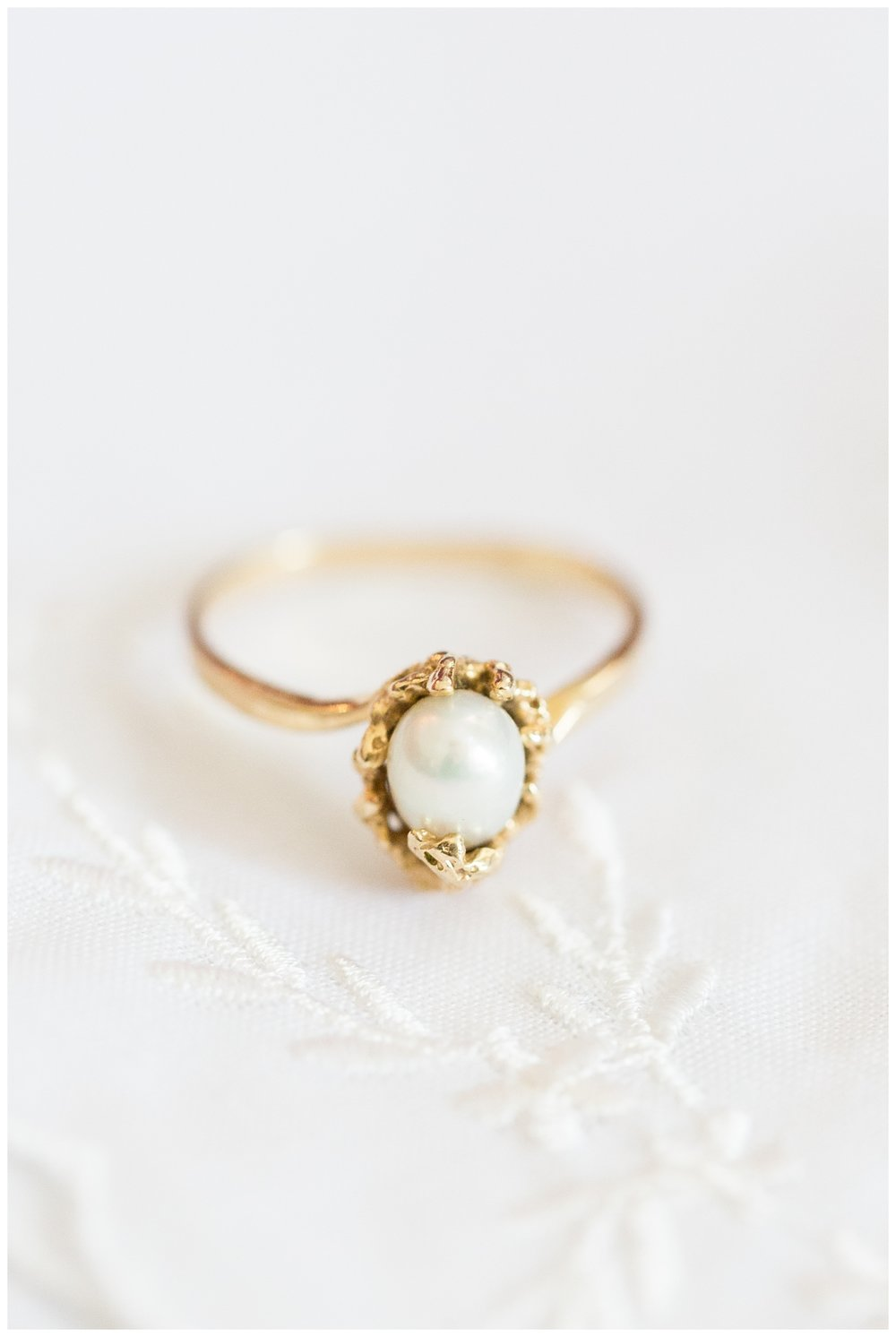 vintage pearl ring photographed by a destination wedding photographer from Napa California