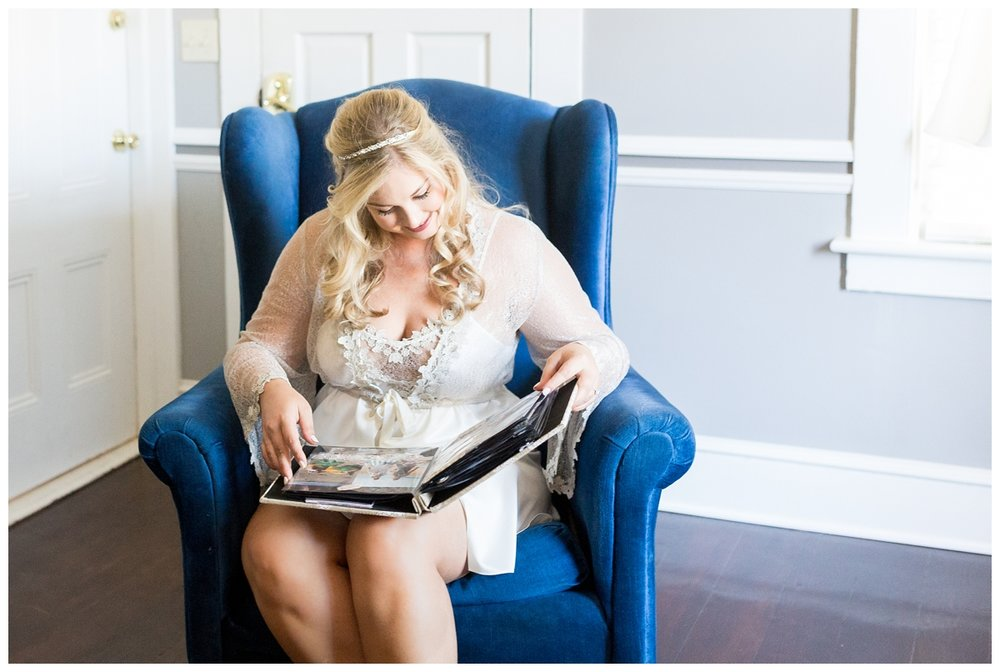bride reading through a scraptbook that her friends made her