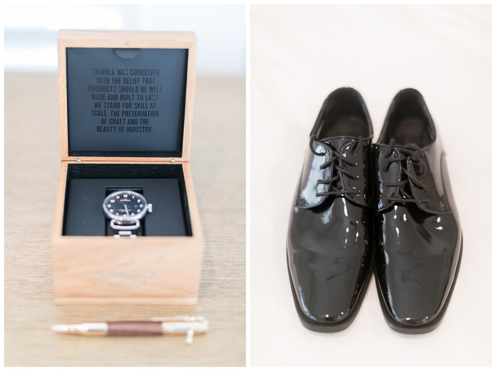 groom puts his black wedding shoes on