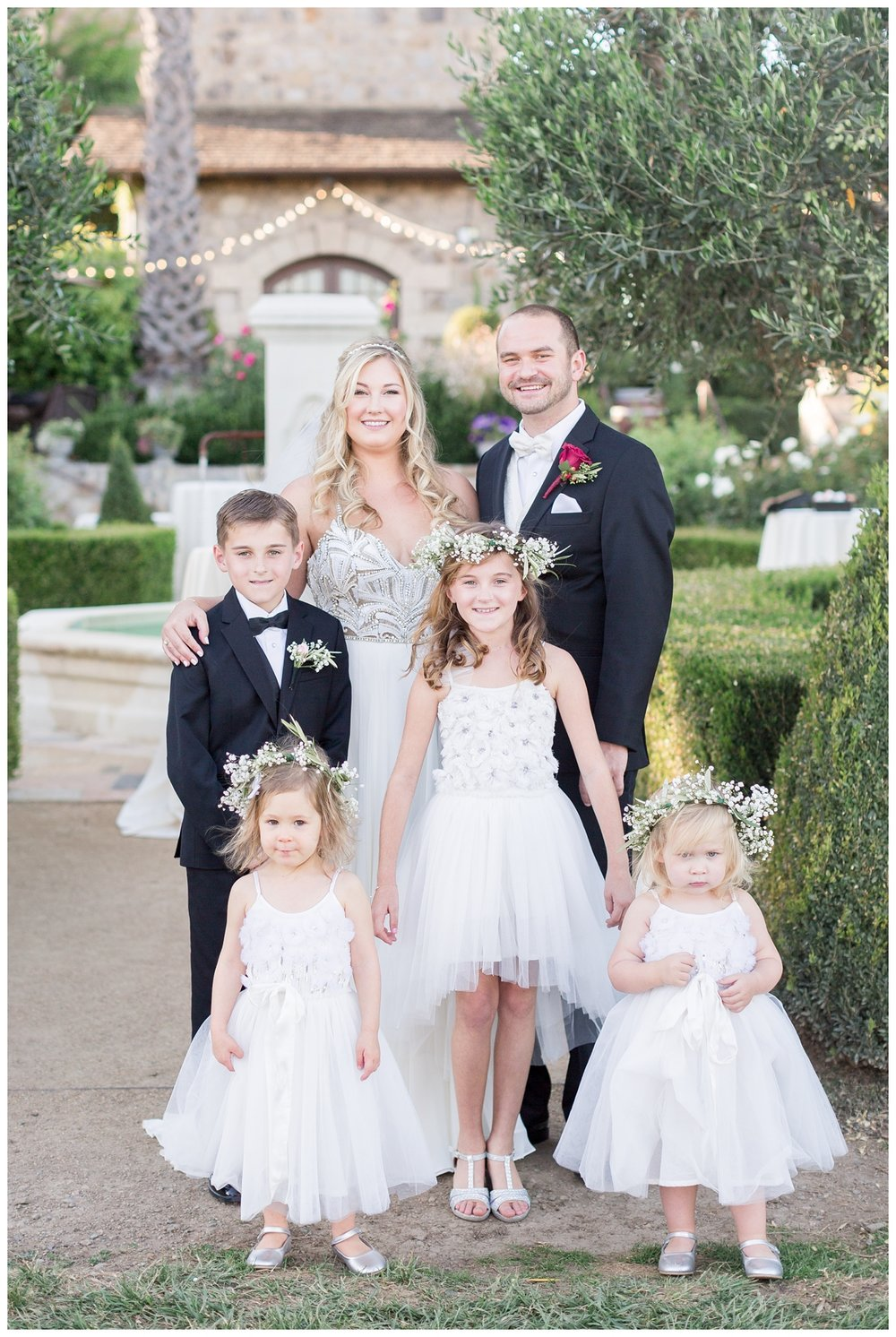 bride and groom with their ring bearers and flower girl at their destination Napa Valley wedding