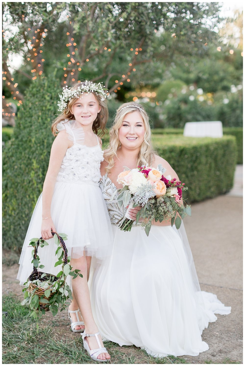 bride with one of her flowers girls at her elegant winery wedding in Napa Valley
