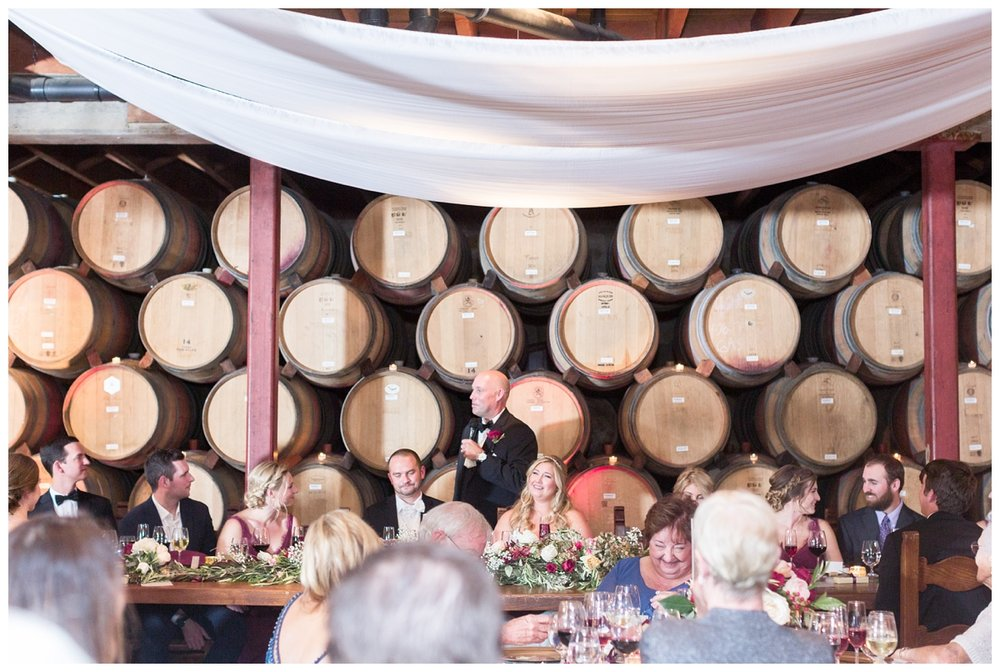 wedding reception speeches inside a barrel room at V. Sattui Winery in Napa Valley