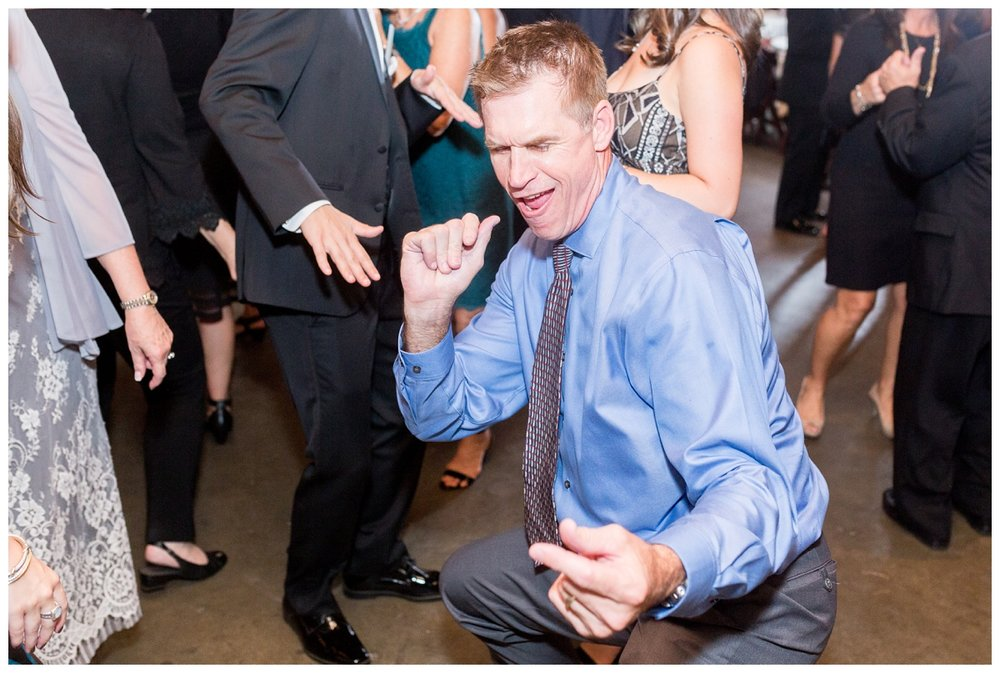 crazy dance moves at an indoor wedding reception at V. Sattui Winery in Napa Valley
